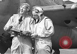 Image of LCDR John Thach and Lt. Edward O'Hare preparing for a flight Kaneohe Hawaii USA, 1942, second 53 stock footage video 65675061850
