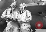 Image of LCDR John Thach and Lt. Edward O'Hare preparing for a flight Kaneohe Hawaii USA, 1942, second 54 stock footage video 65675061850