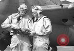 Image of LCDR John Thach and Lt. Edward O'Hare preparing for a flight Kaneohe Hawaii USA, 1942, second 55 stock footage video 65675061850