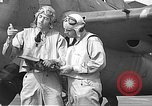 Image of LCDR John Thach and Lt. Edward O'Hare preparing for a flight Kaneohe Hawaii USA, 1942, second 56 stock footage video 65675061850