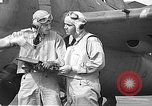 Image of LCDR John Thach and Lt. Edward O'Hare preparing for a flight Kaneohe Hawaii USA, 1942, second 57 stock footage video 65675061850