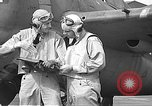 Image of LCDR John Thach and Lt. Edward O'Hare preparing for a flight Kaneohe Hawaii USA, 1942, second 58 stock footage video 65675061850