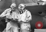 Image of LCDR John Thach and Lt. Edward O'Hare preparing for a flight Kaneohe Hawaii USA, 1942, second 59 stock footage video 65675061850