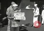 Image of United States sailors learn about end of World War II Hawaii USA, 1945, second 13 stock footage video 65675061871