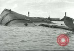 Image of wrecked battleships Pearl Harbor Hawaii USA, 1941, second 62 stock footage video 65675061903