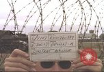 Image of view through barbed wire at airbase operations Vietnam, 1967, second 3 stock footage video 65675061936