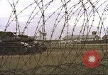 Image of view through barbed wire at airbase operations Vietnam, 1967, second 8 stock footage video 65675061936