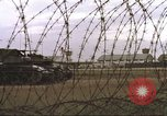 Image of view through barbed wire at airbase operations Vietnam, 1967, second 9 stock footage video 65675061936