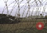 Image of view through barbed wire at airbase operations Vietnam, 1967, second 13 stock footage video 65675061936
