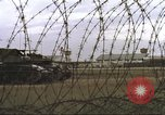 Image of view through barbed wire at airbase operations Vietnam, 1967, second 15 stock footage video 65675061936