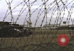 Image of view through barbed wire at airbase operations Vietnam, 1967, second 16 stock footage video 65675061936
