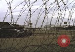 Image of view through barbed wire at airbase operations Vietnam, 1967, second 17 stock footage video 65675061936
