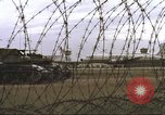 Image of view through barbed wire at airbase operations Vietnam, 1967, second 19 stock footage video 65675061936