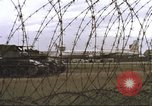 Image of view through barbed wire at airbase operations Vietnam, 1967, second 20 stock footage video 65675061936