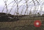 Image of view through barbed wire at airbase operations Vietnam, 1967, second 22 stock footage video 65675061936