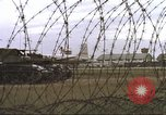 Image of view through barbed wire at airbase operations Vietnam, 1967, second 24 stock footage video 65675061936