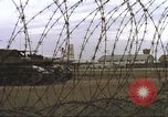 Image of view through barbed wire at airbase operations Vietnam, 1967, second 25 stock footage video 65675061936