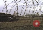 Image of view through barbed wire at airbase operations Vietnam, 1967, second 26 stock footage video 65675061936