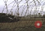 Image of view through barbed wire at airbase operations Vietnam, 1967, second 27 stock footage video 65675061936