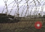 Image of view through barbed wire at airbase operations Vietnam, 1967, second 29 stock footage video 65675061936