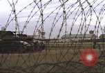 Image of view through barbed wire at airbase operations Vietnam, 1967, second 31 stock footage video 65675061936