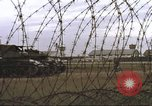Image of view through barbed wire at airbase operations Vietnam, 1967, second 32 stock footage video 65675061936