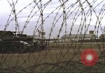 Image of view through barbed wire at airbase operations Vietnam, 1967, second 34 stock footage video 65675061936
