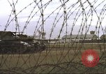 Image of view through barbed wire at airbase operations Vietnam, 1967, second 35 stock footage video 65675061936