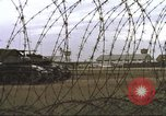 Image of view through barbed wire at airbase operations Vietnam, 1967, second 37 stock footage video 65675061936