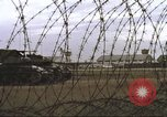 Image of view through barbed wire at airbase operations Vietnam, 1967, second 38 stock footage video 65675061936