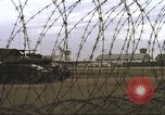 Image of view through barbed wire at airbase operations Vietnam, 1967, second 41 stock footage video 65675061936