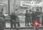 Image of British people carry on after Blitz attack London England United Kingdom, 1941, second 17 stock footage video 65675062256