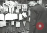 Image of British people carry on after Blitz attack London England United Kingdom, 1941, second 54 stock footage video 65675062256