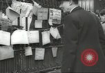 Image of British people carry on after Blitz attack London England United Kingdom, 1941, second 55 stock footage video 65675062256