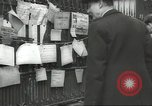 Image of British people carry on after Blitz attack London England United Kingdom, 1941, second 57 stock footage video 65675062256