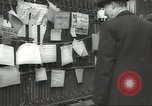 Image of British people carry on after Blitz attack London England United Kingdom, 1941, second 58 stock footage video 65675062256