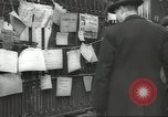 Image of British people carry on after Blitz attack London England United Kingdom, 1941, second 59 stock footage video 65675062256
