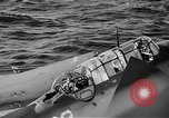Image of Gunner buried at sea in TBF avenger aircraft Manila Philippines, 1944, second 11 stock footage video 65675070253