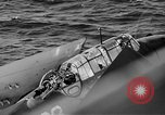 Image of Gunner buried at sea in TBF avenger aircraft Manila Philippines, 1944, second 13 stock footage video 65675070253