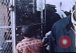 Image of looters robbing Tabbs shoe store Washington DC USA, 1968, second 7 stock footage video 65675070918