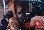 Image of looters robbing Tabbs shoe store Washington DC USA, 1968, second 25 stock footage video 65675070918