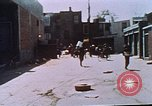 Image of looters robbing Tabbs shoe store Washington DC USA, 1968, second 40 stock footage video 65675070918