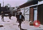 Image of looters robbing Tabbs shoe store Washington DC USA, 1968, second 46 stock footage video 65675070918