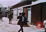 Image of looters robbing Tabbs shoe store Washington DC USA, 1968, second 47 stock footage video 65675070918
