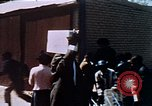 Image of looters robbing Tabbs shoe store Washington DC USA, 1968, second 49 stock footage video 65675070918