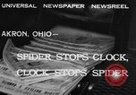 Image of spider in clock Akron Ohio USA, 1932, second 2 stock footage video 65675070961