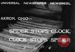 Image of spider in clock Akron Ohio USA, 1932, second 5 stock footage video 65675070961