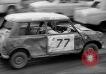 Image of jalopies crashed at demolition derby United Kingdom, 1965, second 13 stock footage video 65675071050