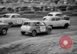 Image of jalopies crashed at demolition derby United Kingdom, 1965, second 14 stock footage video 65675071050