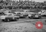 Image of jalopies crashed at demolition derby United Kingdom, 1965, second 15 stock footage video 65675071050
